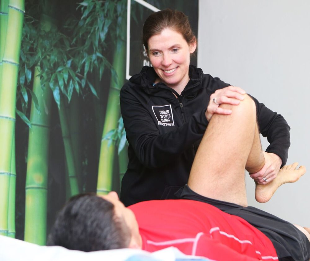 Orla Magorrian Physiotherapist with Dublin Sports Clinic assessing a patient.