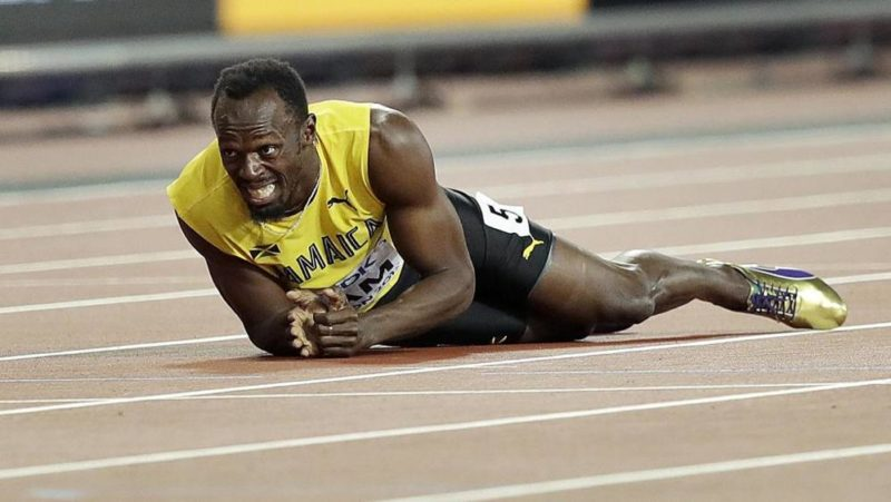 Usain Bolt lies on ground after tearing his hamstring during the final of the 4 x 100m relay at the IAAF World Athletics Championships in London 2017