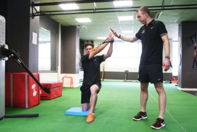 Physiotherapist directs injured patient through exercises that will contribute to this rehabiliation