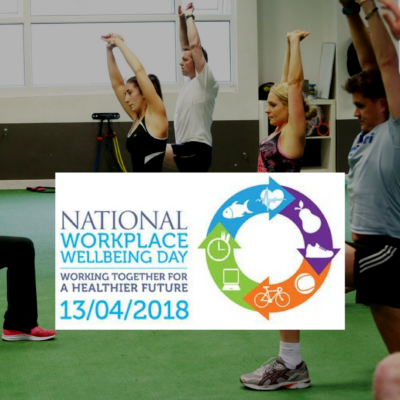 Employees stretching during workplace wellness day 2018